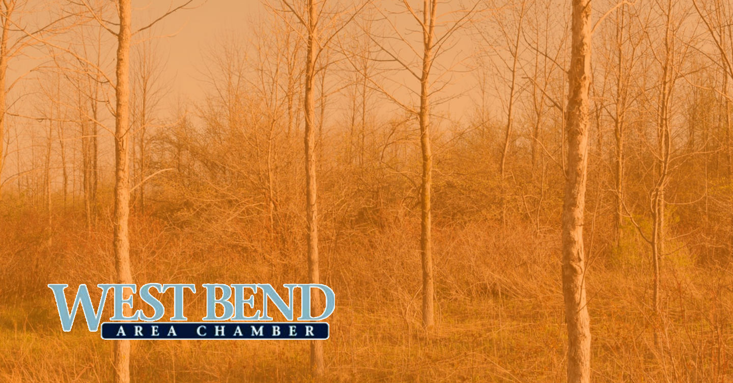 overlaid image of woods in west bend with west bend chamber logo