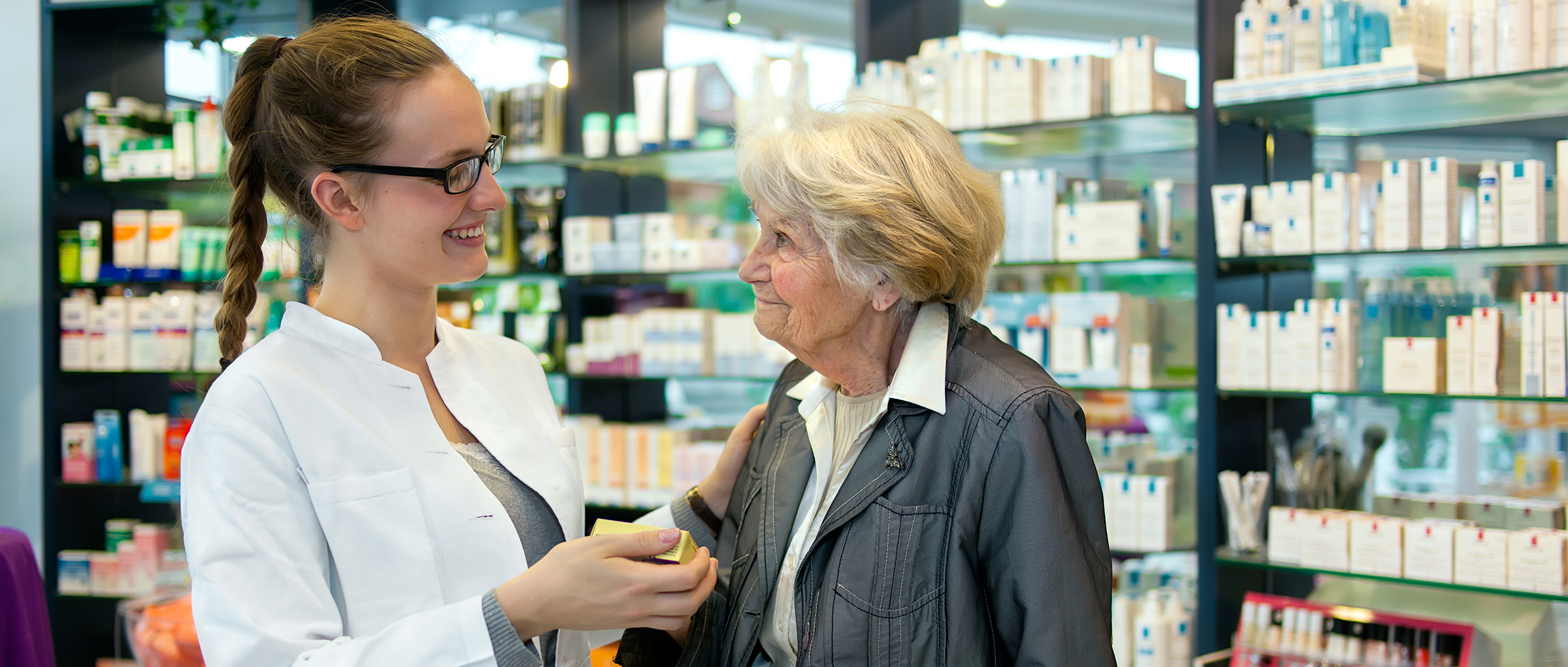 pharmacist going over pharmacy benefit with medicare member