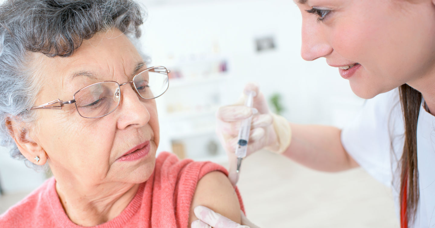 person receiving shingles shot from personal doctor